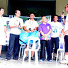 BACOLOD. Green Archers Globe Football Club manager Monchu Garcia (L), assistant coach Franklin Muescan (2nd from right) and De la Salle University technical director Hans Peter Smit (R) turn over 26 Molten footballs to Don Bosco Technical Institute represented by (L-R) rector Fr. Godo Atienza, SDB; coach Itek Baldava; and principal Fr. Gene Taqueban, SDB during the Green Archers' football clinic at the school last Saturday. The team then played with the clinic participants at the Don Bosco field (right photo). (Butch S. Bacaoco)