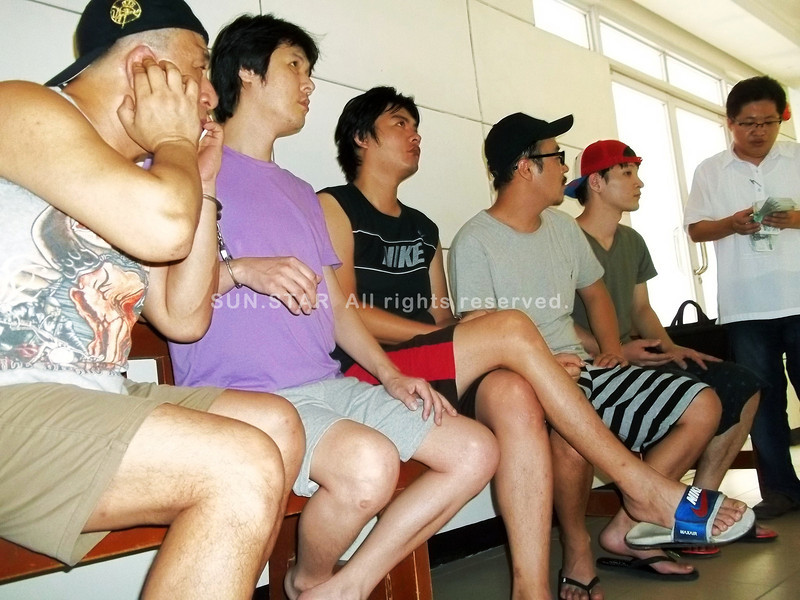 CEBU. (From left) Jeong Jong Ho, 42; Kang Jae Wook, 39; Park Sangmin, 32; An Ji Hwan, 32; and Park In Gyu, 30, wait inside the Lapu-Lapu City Hall of Justice to post bail. Time ran out on them, however, and they will have to try again on Wednesday next week. Both Monday and Tuesday are non-working days. (Alan Tangcawan)