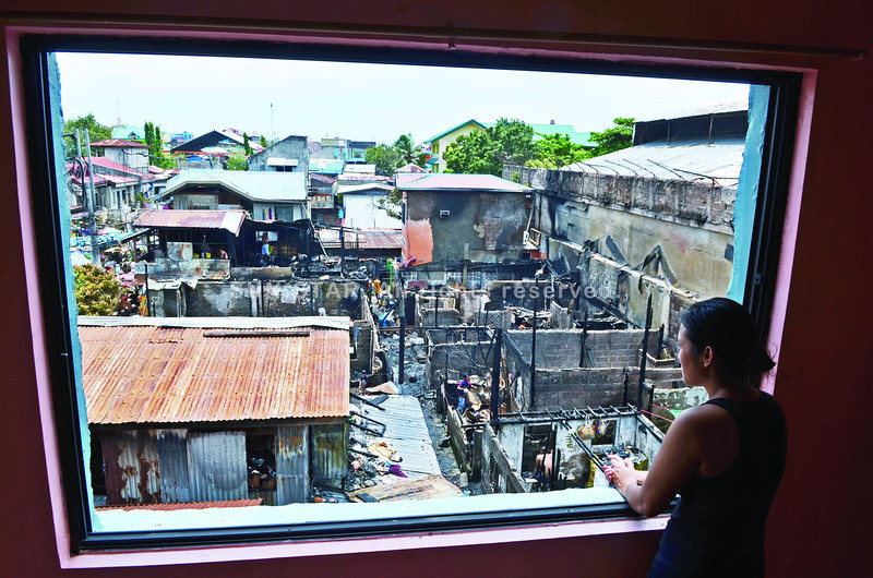 Destruction caused by Sawang Calero fire