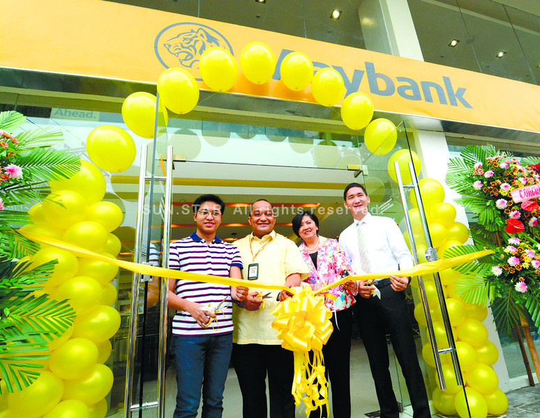 Opening of Maybank Lahug branch,(L-R) Michael Yu owner of JY Square,Mr. Neil Darwin Credo Maybank branch head Ms Susan Catindig Maybank region 4 Head and Mr. Joel  Carranto Maybank Community distribution Head.<br /> <br /> ssd foto/allan defensor