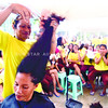 CEBU. A haircutter, a gay inmate at the Lapu-Lapu city jail tries to find the right style for a female inmate. About 700 Lapu-Lapu male and female inmates are donating their hair to stop the oil spill at the Mactan channel. (Alan Tangcawan)