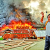 DAVAO. An incensed man rants at the firemen who responded to the fire incident as the fire razed a total of 270 houses Thursday at Muslim Village on Km. 11 in Sasa, Davao City. (Seth Delos Reyes)