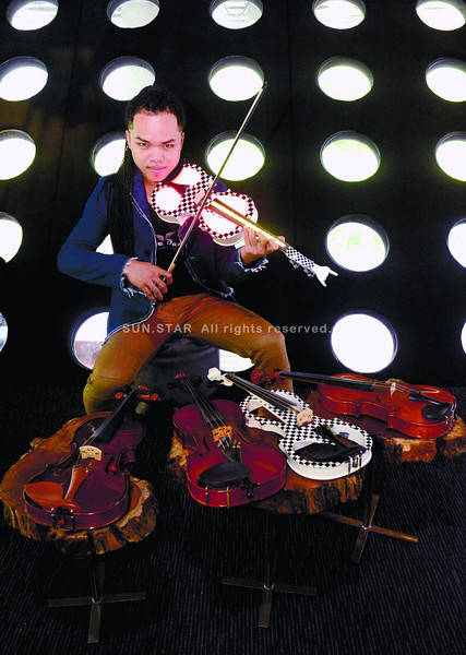 Juleous, the Show Violinist. He invests in his performance violins: classic and funky instruments. One even lights up. (Allan Defensor photo/Sun.Star Cebu)