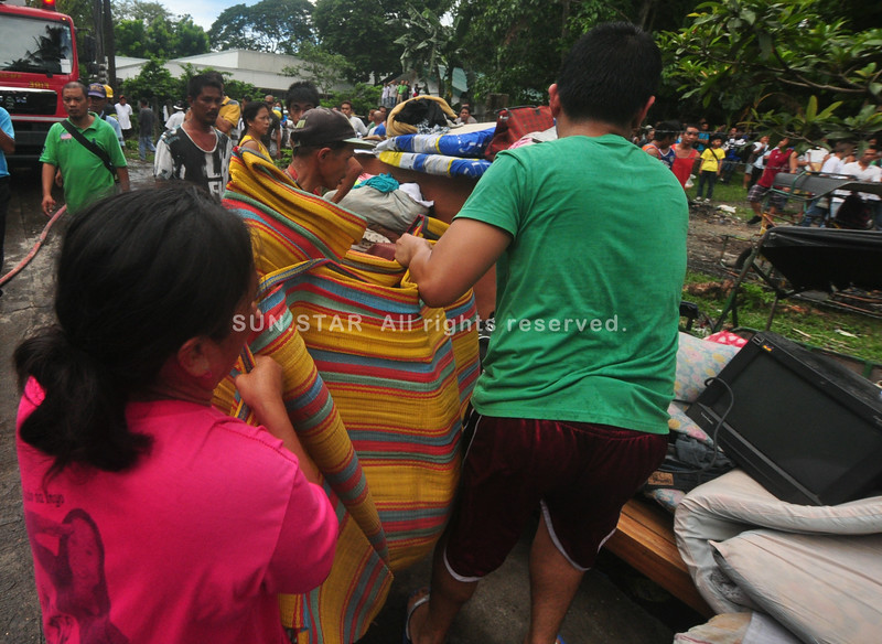 Bacolod City fire victims salvage belongings