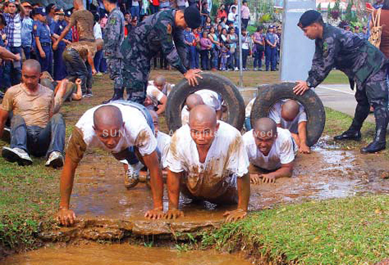 The 125 newly-recruited policemen and women in the Cordillera region undergo rigid physical training and mental test during their oath taking as police recruits at Camp Bado Dangwa on Wednesday. (Photo by Mauricio Victa of Sun.Star Baguio)