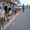 Candles lighted along Tacloban City street