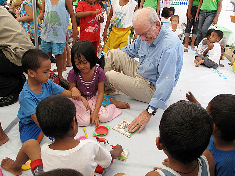 Tony Blake playing with the children