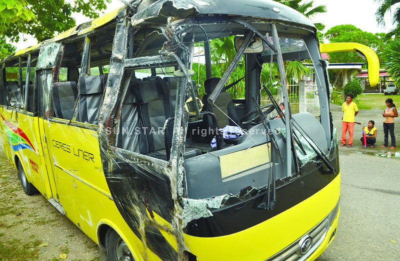 This bus sped downhill in Sitio Bangko-Bangko, Barangay Balhaan in Badian town, Cebu before it hit a post and a tree, then fell on its side shortly after 7 a.m. Monday, December 16, 2013. (Photo by Amper Campaña of Sun.Star Cebu)