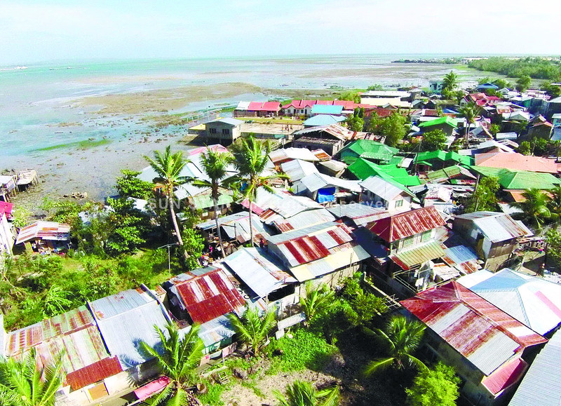 Cebu coastal neighborhood damaged by Typhoon Ruby
