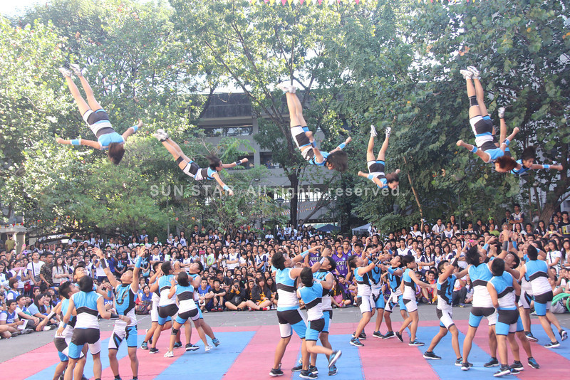 PAMPANGA. The Angeles University Foundation (AUF) Great Danes Pep Squad displays their acrobatic moves during the opening ceremonies of Pasiklaban 2012. Applauding them (Chris Navarro)