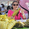 PAMPANGA. Sta. Rita Mayor Yolly Pineda savors the delicious varieties of homemade suman during Sunday's 3rd Suman Festival. (Chris Navarro)