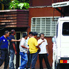 QUESTIONED. Caretaker Renato Vertucio (right) is being grilled by members of the Theft and Robbery Section of the Cebu City Police Office outside the GSP building in Camp Marina, Barangay Kalunasan. Someone broke into the office of the regional executive director on the second floor and took P600,000 from the vault. (Sun.Star Photo/Amper Campana)
