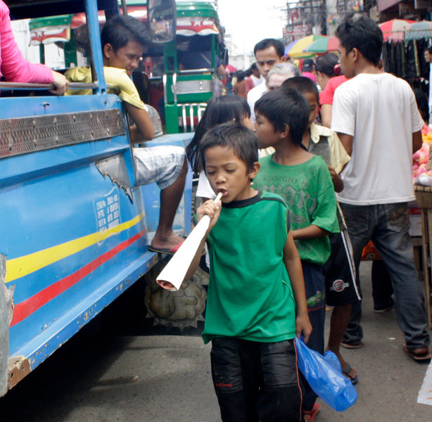 "FOTO 2 - This kid is seems enjoying his newly bought ""tarotot"" as he is waiting for the new year celebration. This is more safer for children than firecrackers. (PHOTO BY JOEY P. NACALABAN)"