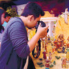 "NATIVITY TRADITION. A guest takes shots of a miniature nativity scene during the opening of the ""Belen sa Casa Gorordo."" The setting up of a belen, or nativity scene, is one of the traditions of the Gorordo family. The Ramon Aboitiz Foundation Inc. launched the display at the Casa Gorordo Museum in Cebu City last Dec. 6. (Foto by Allan Cuizon)"