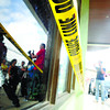 CEBU. Bullet holes riddle the glass panels of the Black Panda Travel and Tours shop in Mandaue City.(Allan Cuizon)