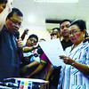 Acting Governor Agnes Magpale (right) take her oath of office this morning from DILG 7 Regional Director Ananias Villacorta (left) after the suspension of Governor Gwen Garcia this morning........( Sunstar-Amper Campaña 12 19 2012 )