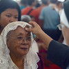 DAVAO. A nun marks the forehead of each parishioner with black ashes in the sign of the cross, which a worshipper traditionally retains until it wears off, as Roman Catholics all over the world commemorated the Ash Wednesday, the start of the Lenten Season, at San Pedro Cathedral in Davao City. (King Rodriguez)