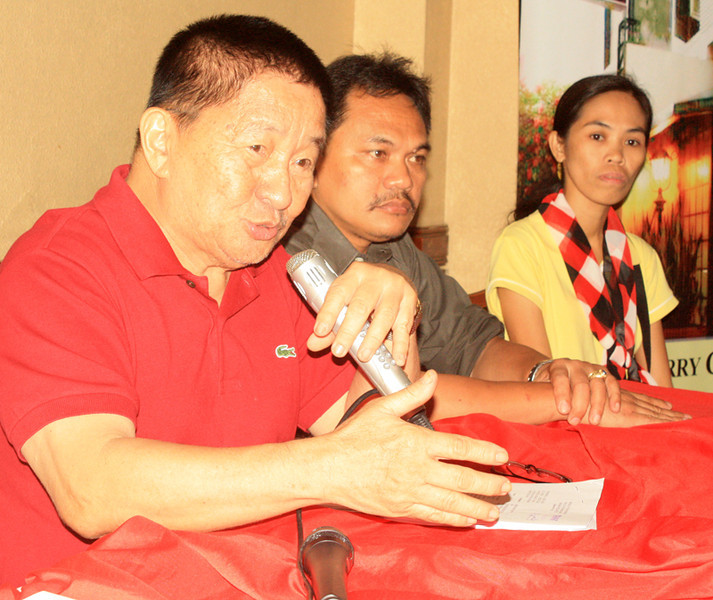 CAGYAN DE ORO. Lawyer Homobono Adaza (far left) shows to the media the documents containing the details of the charges they filed against the Romualdos of Camiguin province during a press conference on Monday. (Joey P. Nacalaban)