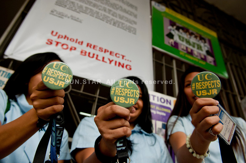 CEBU. Students of the University of Cebu (UC) show the pins that their school has distributed to show its support to University of San Jose-Recoletos, one of whose students was involved in a video sex scandal. UC's campaign is also aimed at putting a stop to bullying among students. (Photo by Alex Badayos Sun.Star Cebu)