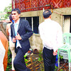 A VERY BUSY GROOM.  Dionisio Marimon (left), still in his wedding attire, surveys the damage to the house he was renting with his bride Ana Marie. They were about to host their reception when the flames reached them in Sitio Renaissance, Bulacao-Pardo. (Sun.Star Cebu Photo/Alex Badayos)