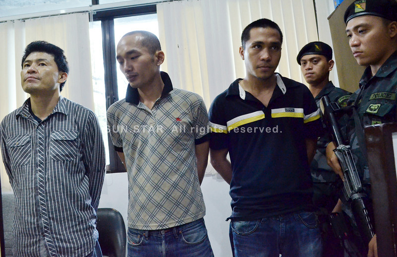 "ON THE ROAD NO MORE.  Car theft suspects (from left) Kim Jae Young (alias Leo Lim), Hong Seo Yong (alias Luis) and Raphael ""Raprap"" Montilla are presented by a joint team from the Central Visayas and Mandaue City police offices. (Sun.Star Photo/Amper Campana)"
