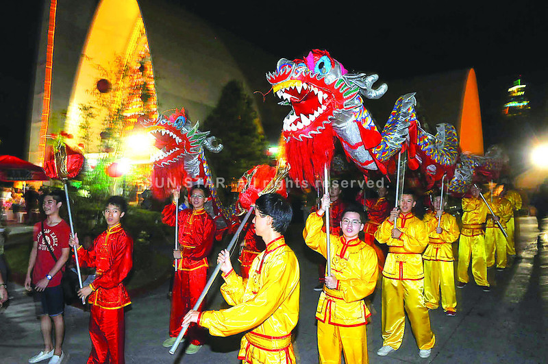 DANCES WITH DRAGONS. Performers get ready for a dragon dance at the Archdiocesan Shrine of the Most Sacred Heart of Jesus in Cebu City, as the Chinese community celebrates the New Year. These performers are from the Sacred Heart School-Ateneo de Cebu. (Photo by Arni Aclao of Sun.Star Cebu)