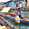 DAVAO. A man who tends to seaweeds off Tibungco, Davao City, is done for the day and is about to tie his bangka on his way home. (Seth delos Reyes)