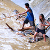 DAVAO. Riverside residents use ropes and poles to snag wood brought down by Davao River to be later chopped, dried, and sold as firewood. (Seth delos Reyes photo)