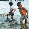 DAVAO. Mga bata sa Punta Dumalag nagpalutaw sa ilang dulaang sakayan nga gama sa styrofoam sa dagat diin gitaho nga dunay nakita nga dolphin duol sa maong dapit kagahapon. (Seth delos Reyes)