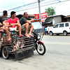DAVAO. Menfolk ride on top of their motorized hog carrier after having successfully negotiated to buy full-grown hogs from different backyard growers in Tibungco. (Seth delos Reyes)