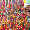 TRINKETS. Baguio residents can't seem to get enough of these colorful beads from Cebu sold in one of the stalls at Session Road in Bloom. Aside from food, similar products make the activity another hit in the ongoing Baguio Flower Festival. (Photo by Mauricio Victa)