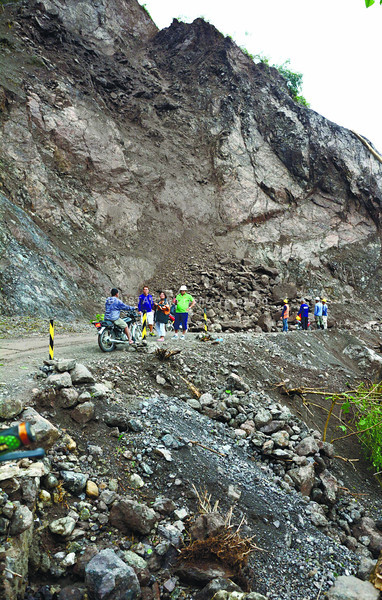 Tropical storm Basyang triggered landslides in Manipis, Talisay City, one of at least 10 such incidents reported nationwide. (Alex Badayos photo)