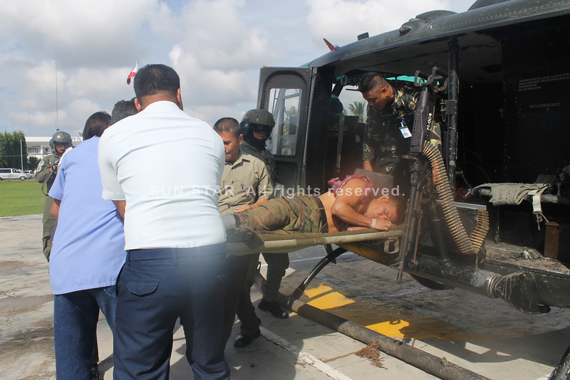 ZAMBOANGA. A photo handout of the Eastern Mindanao Command (Eastmincom) shows one of the six soldiers wounded in a clash and explosion in Davao del Sur being airlifted Monday to a hospital. (Bong Garcia)