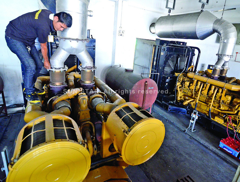 An engineer of NCCC Mall in Matina, Davao City looks after the huge generator sets following Thursday's city-wide power interruption caused by power disturbance experienced by the National Grid Corporation of the Philippines. (King Rodriguez)