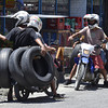 DAVAO. Motorcyclists transport several tires while traversing Roxas Avenue, unmindful that two-wheeled motorcycles are not designed to carry such huge cargoes. (King Rodriguez)