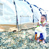 CEBU. A child plays outside a tent in the South Road Properties in Cebu City, where survivors of Typhoon Yolanda have been taking shelter. (Allan Defensor)