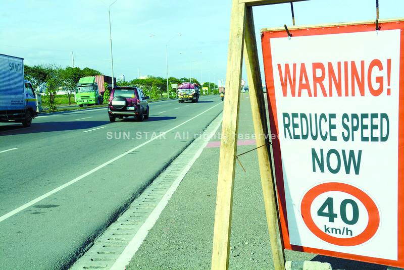 Warning sign along Cebu SRP