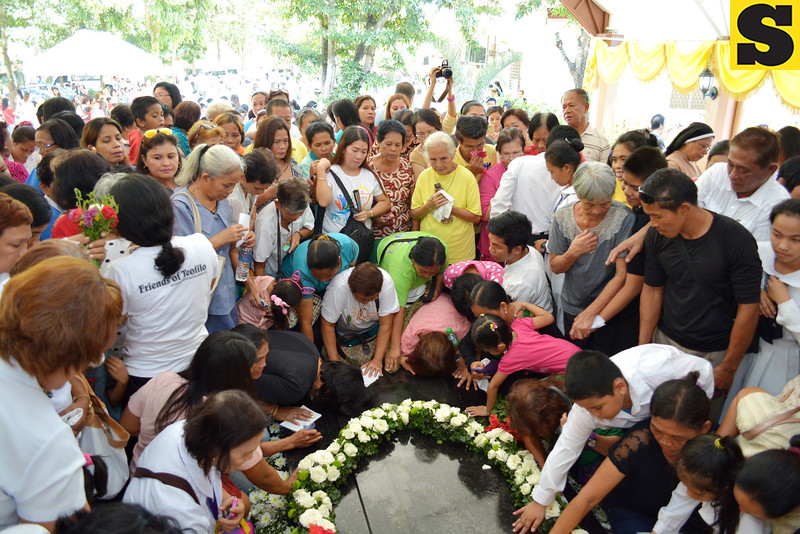 Pilgrims, followers and clergy members pay their respects at the tomb of the late Archbishop Teofilo Bastida Camomot