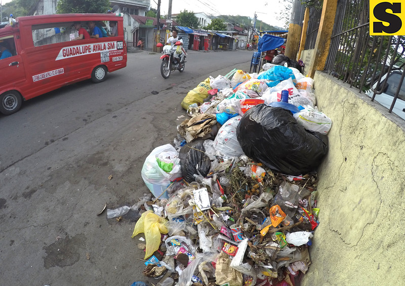 Garbage accumulates outside the fence of Guadalupe Church