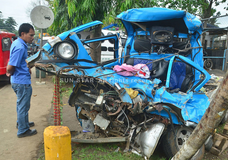 DAVAO. A crumpled heap of metal is all that remains of the multicab carrying the Sahadin family that was crushed by a speeding Isuzu Forward truck along the highway in Los Amigos, Tugbok District. (Seth delos Reyes)