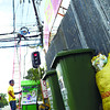 Garbage still on the roadside near Abellana National School as of 11:30 o'clock this morning while PLDT contractors (background) prepare the free wi-fi connections for this Sinulog 2013 festivities....( Sunstar-Amper Campaña 1 9 2013 )