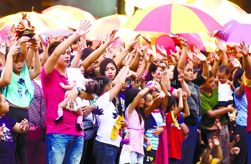 THE CHILDREN'S MASS.  Hundreds of families turned up at the Basilica Minore del Sto. Niño for the Children's Mass.  (Sun.Star Photo/Alex Badayos)