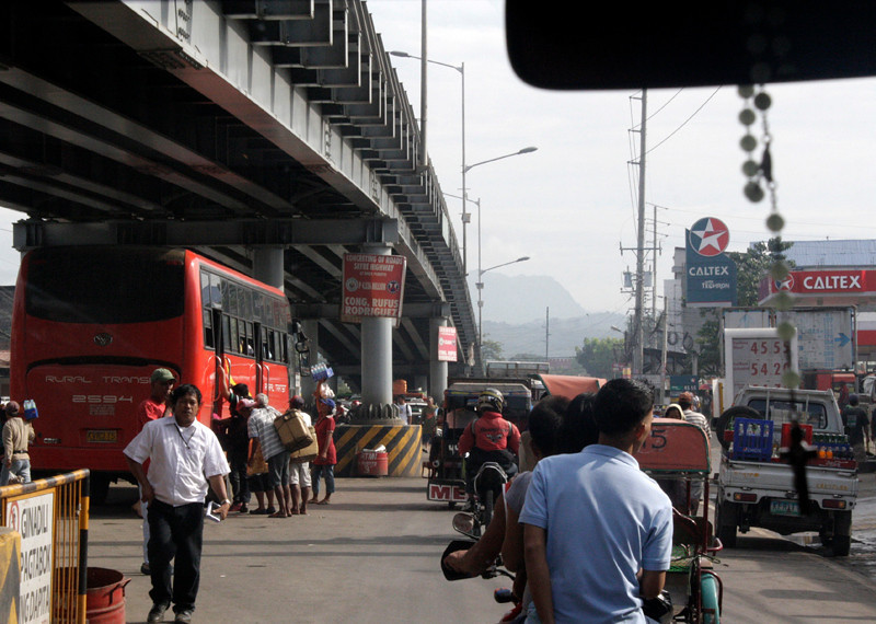 NEW TERMINAL. A passenger bus utilizes the area under a flyover in Barangay Puerto as its terminal. Is this allowed? (Joey P. Nacalaban)