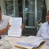 ZAMBOANGA. Lamitan City Mayor Roderick Furigay shows his complaint affidavit for the charges he filed against his vice mayor. At his right is his legal counsel, lawyer Quirino Esguerra Jr. (Bong Garcia)