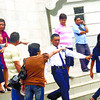 TENSION AFTER HEARING. A security guard tries to prevent a fight between members of the Pique family (left) and supporters of Bella Ruby Santos. Santos is one of the accused in the kidnapping and homicide case fi led by Renante Pique (in striped shirt) and his wife Ligaya (to Renante's left), after the death last year of their six-year-old daughter Ellah Joy. (Sun.Star Cebu/Amper Campana)