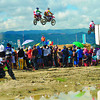 HIGH-FLYING STUNTS.  Spectators enjoy the stunts in the Kopiko Astig 3-in-1 Supercross Series in the South Road Properties. Denmark's Nikolaj Larsen, the world No. 6, dominated the race.  (Sun.Star Photo/Amper Campana)