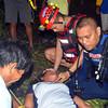 DAVAO. Gitabang sa mga sakop sa Urban Search and Rescue Team si Virginia Gascon, inahan ni Felix Gascon, kay nakuyapan sa kaguol nga wa nakit-i ang iyang anak niadtong Martes sa gabii didto sa Purok 6, Barangay Langub, siyudad sa Davao. (Seth Delos Reyes)