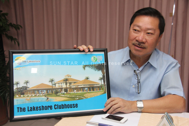 PAMPANGA. CCEI president and CEO Architect Nestor S. Mangio shows a picture of the newly completed Lakeshore clubhouse. (Chris Navarro)