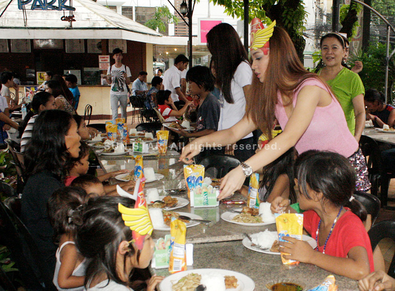 Stephanie Mae Sol in her Darna costume spending her 23rd birthday with the less fortunate children in Cagayan de Oro. (Joey P. Nacalaban)
