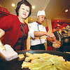 THE RIGHT WAY. Ivy Ng of Hotel Supreme prepares tikoy for guest during the launching press confernece of the 2013 Spring Festival, better known as Chinese New Year. (Photo by JJ Landingin of Sun.Star Baguio)
